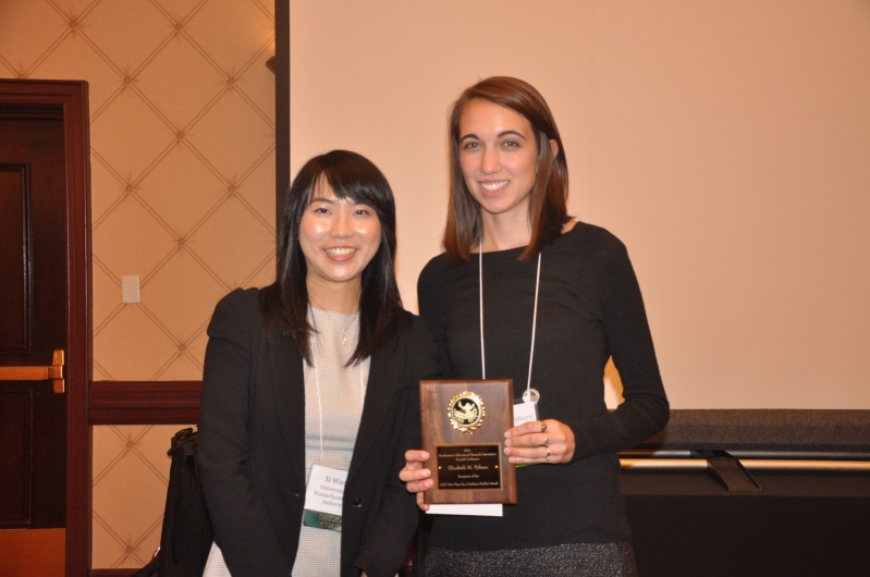 Xi Wang presents award to Elisabeth Pyburn